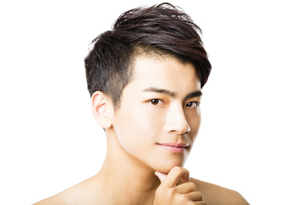 asian man smiling: Closeup portrait of attractive young man face Stock Photo