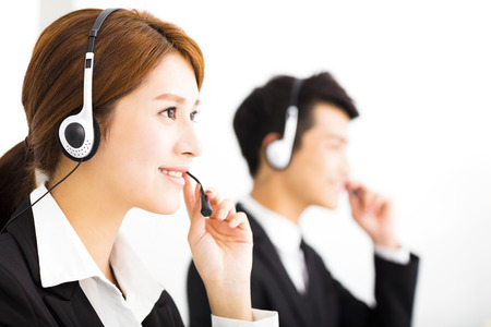 headset woman: young business people working with headset in office