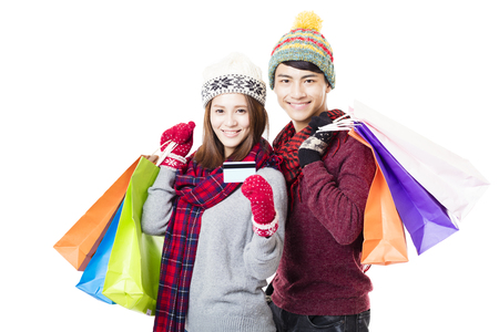 happy shopping: happy couple shopping together with winter wear