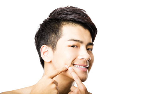 handsome young man Squeezing pimple