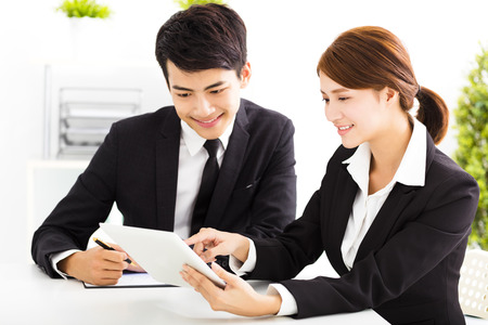 happy business man and woman working  in office Stock Photo