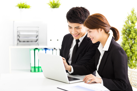 japanese people: happy business man and woman working  in office Stock Photo
