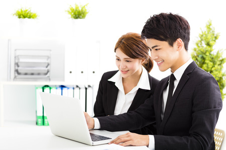 asian on laptop: happy business man and woman working  in office Stock Photo