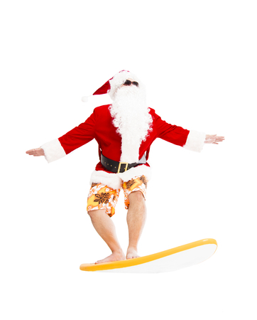 surfing: Happy Santa Claus surfing with surf board