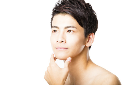 asian guy: Closeup portrait of attractive young man face Stock Photo