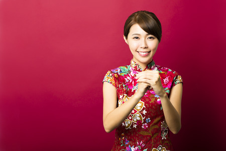 chinese: beautiful young asian woman with congratulation gesture Stock Photo