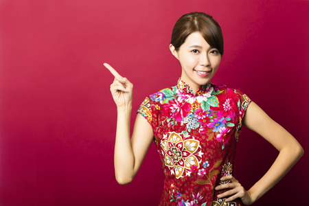 charming woman: smiling young chinese woman with showing gesture