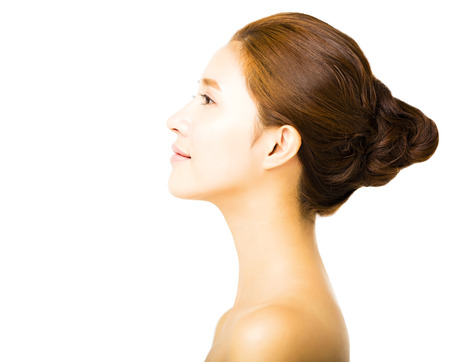 from side: side view young smiling  woman with clean face