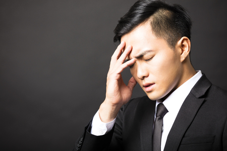 tired businessman: Businessman in depression with black background