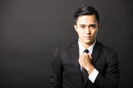 chinese style: young asian businessman on black background Stock Photo