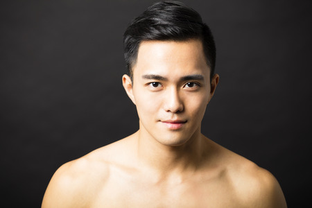asia: Closeup portrait of attractive young man face Stock Photo