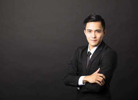 young asian businessman on black background Stock Photo