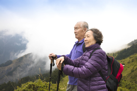 asian old man: happy asian senior couple hiking on the mountain