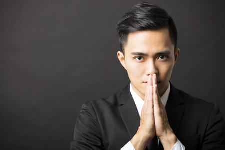 pray: young business man with pray gesture Stock Photo