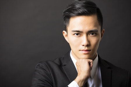 portrait: young asian businessman on black background Stock Photo