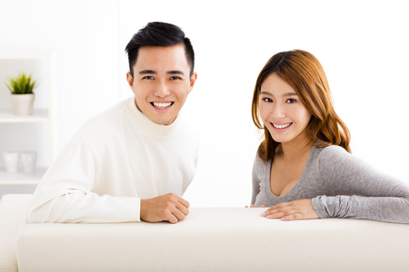 asia people: happy young couple sitting in sofa Stock Photo