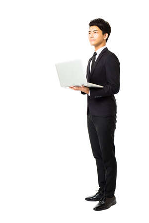 standing businessman: full length business man with laptop isolated on white