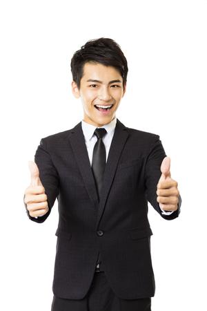 hombre de negocios: joven hombre de negocios con los pulgares arriba gesto