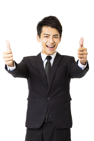 men in suit: young business man with thumbs up gesture