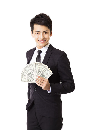 man holding money: happy young business man holding money
