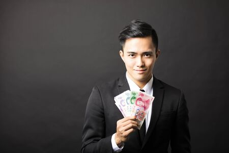 businessman holding yuan money in his hands