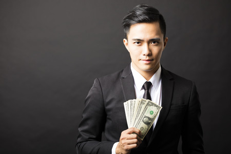 young business man holding money