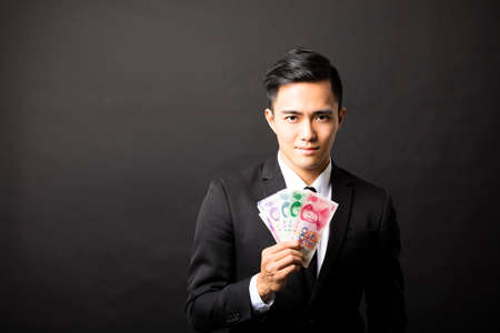 yuan: businessman holding yuan  in his hands