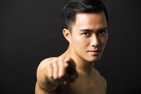 asian man face: attractive young man face finger pointing Stock Photo