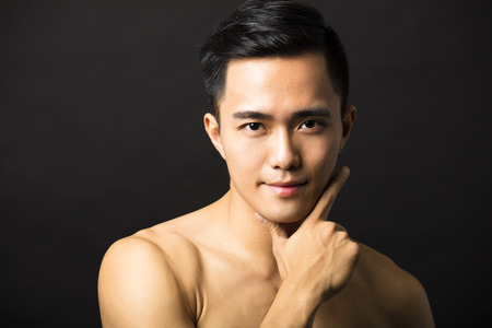 attractive man: Closeup portrait of attractive young man face Stock Photo
