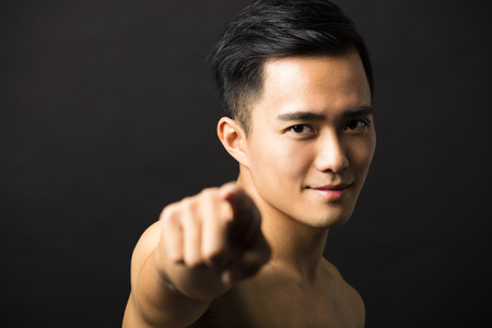 male face: attractive young man face finger pointing Stock Photo