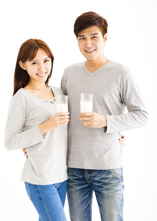 Young asian smiling couple drinking milk