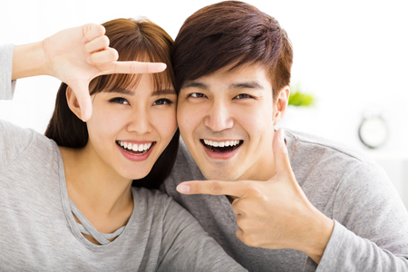 boy room: Closeup portrait of beautiful happy couple Stock Photo