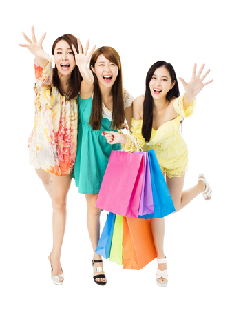 shopping sale: young woman group  with shopping bags running and catching