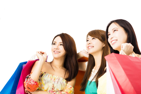 asian lady: Group of happy young woman with shopping bags looking up