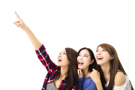 finding a mate: group of happy young  women looking and pointing something Stock Photo