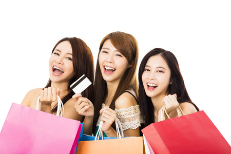 credits: Group of happy young woman with shopping bags and credit card Stock Photo