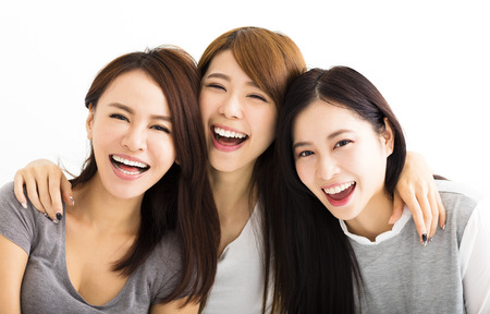 Closeup happy Young Women Faces Looking at Camera