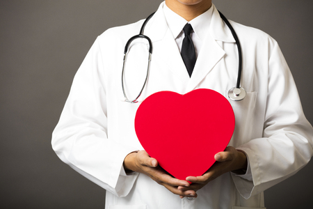 beating: closeup of medical doctor hands with heart
