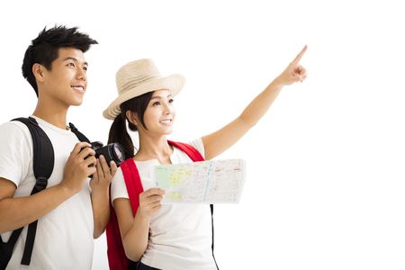 Happy tourists couple holding map and camera