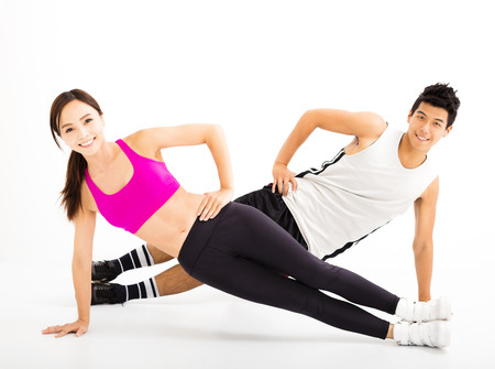asian sport: happy couple doing fitness exercises on the white background Stock Photo