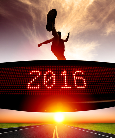 challenge: young runner jumping and crossing 2016 display Stock Photo