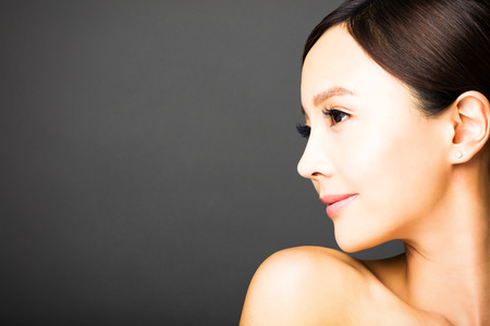 face and shoulders: side view of beautiful young   woman  face Stock Photo