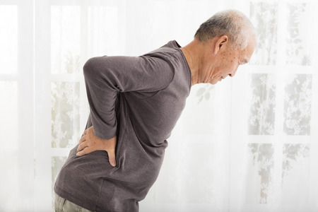 senior pain: senior man with Pain in back Stock Photo