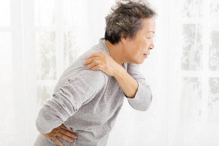 senior pain: senior woman suffering in shoulder pain