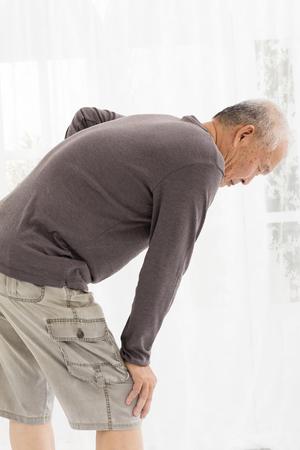 hurt: senior man with  knee pain