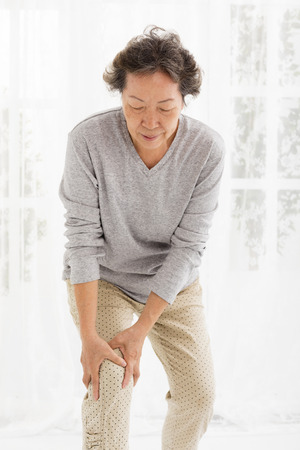 articulation: senior woman with  knee pain Stock Photo
