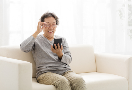 asian senior woman touching the smart phone