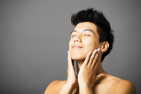 asian man: Closeup portrait of attractive young man face Stock Photo