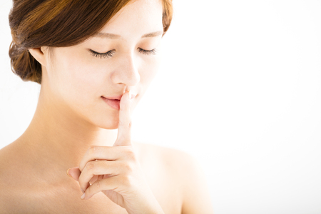 keep: closeup  beautiful woman with finger on lips