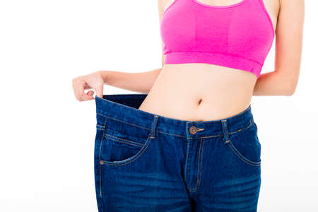 slim body: beautiful slim young woman with big jeans Stock Photo
